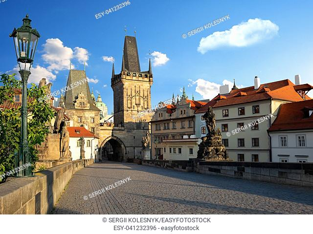 Early morning on Charles Bridge in Prague at summer