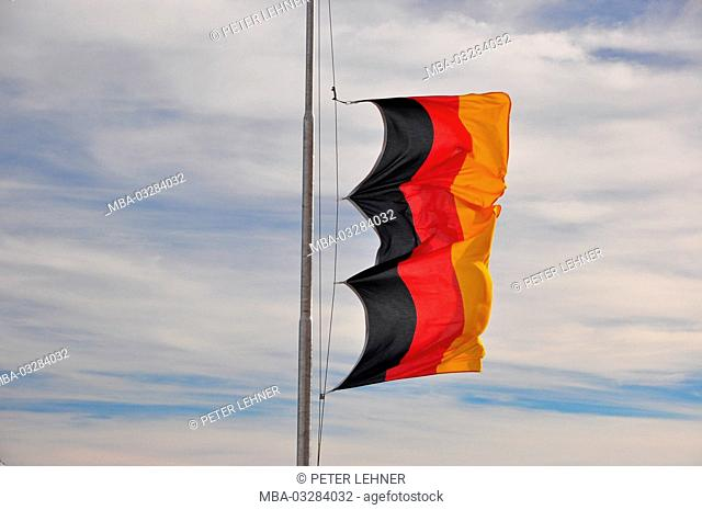 German flag, pole, storm, flapping