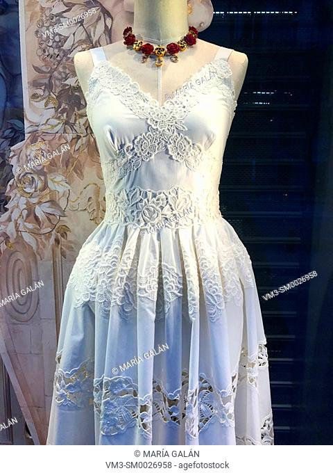 White cotton dress in a shop window. Madrid, Spain