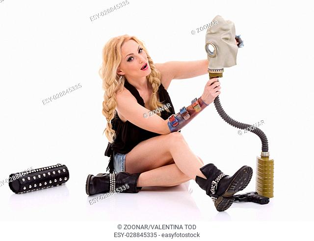 Beautiful woman with gun and gas mask