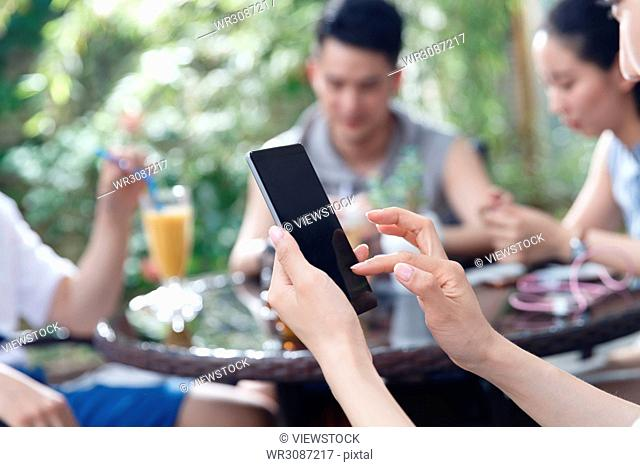 Young people watch mobile phones