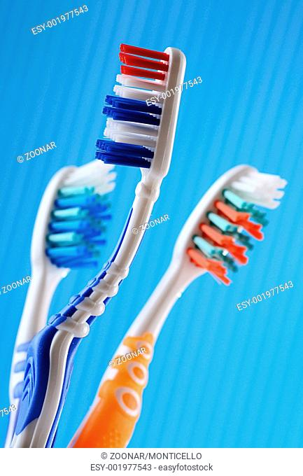 Composition with three toothbrushes