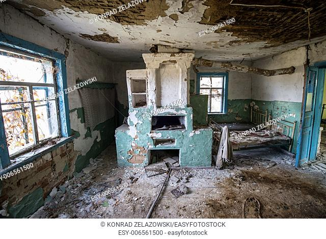 big stove in wooden cottage in small abandoned village called Stechanka, Chernobyl Nuclear Power Plant Zone of Alienation, Ukraine