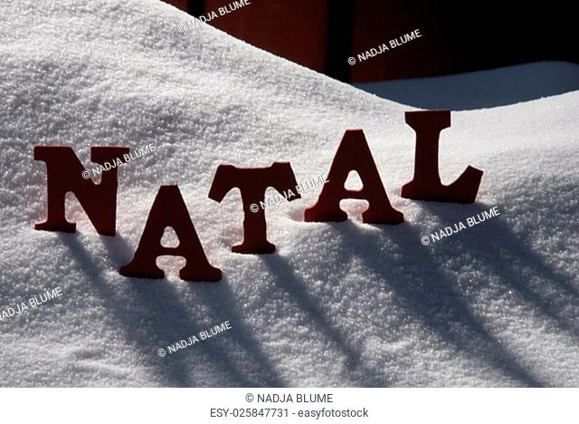 Red Letters On White Snow As Christmas Card. Portuguese Word Natal Means Christmas. Snowy Scenery And Atmosphere. Rustic Vintage Wooden Background