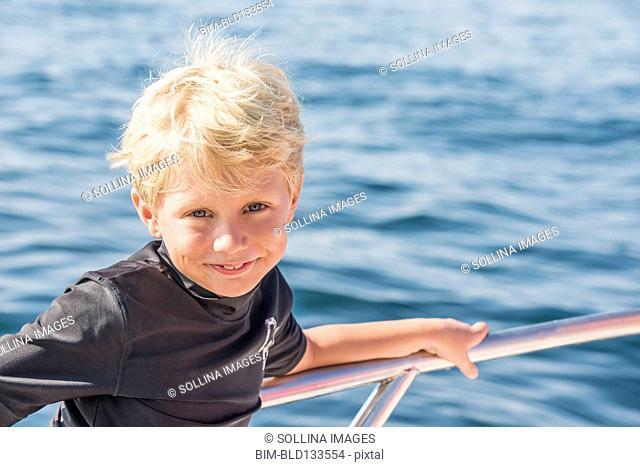 Caucasian boy smiling on boat