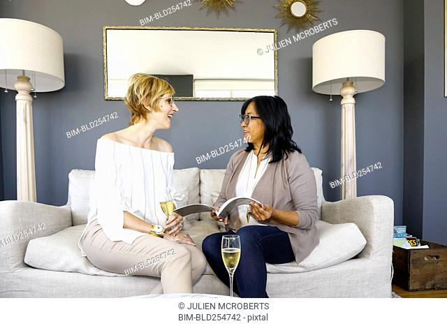 Women with champagne reading book