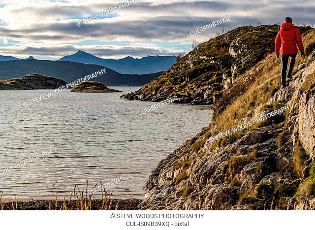 Woman hiking on Sommaroy Island in autumn, Arctic Norway