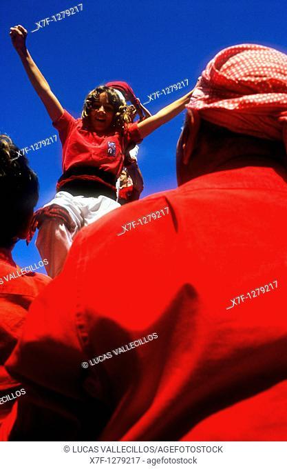 Celebrating a great success Nens del Vendrell 'Castellers' is a Catalan tradition Biannual contest  bullring Tarragona, Catalonia,Spain