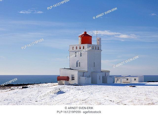 Dyrhólaey lighthouse at Vík í Mýrdal on the central south coast of Iceland in the snow in winter