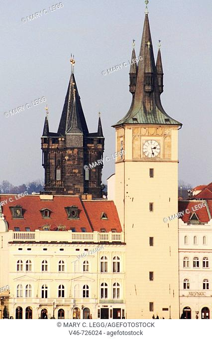 The rooftop of Novetneho Lavka and the Old Town Water Tower with the Old Town Tower in background by the Charles Bridge Prague, Czech Republic on a late