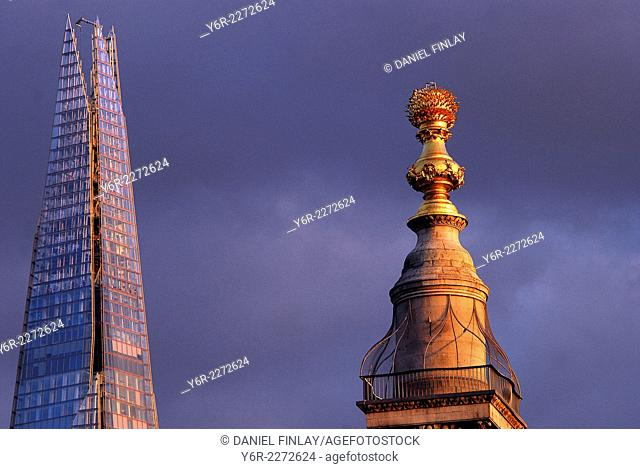 The Shard and The Monument in warm evening light in London, England