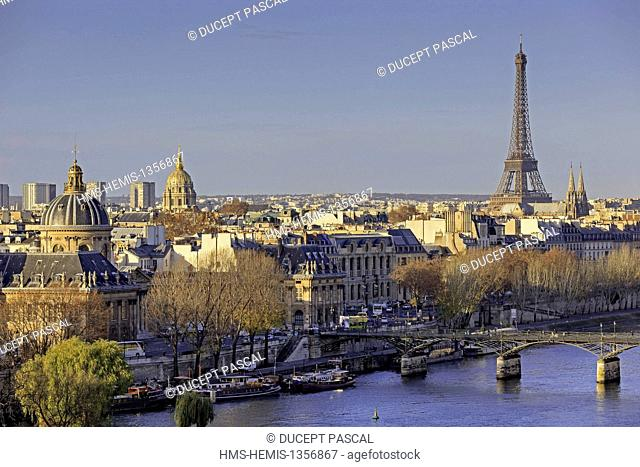 France, Paris, area listed as World Heritage by UNESCO, the Eiffel Tower and the pont des arts (arts bridge), the left bank with the domes of the French...