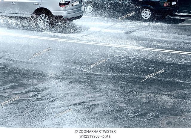 splashing cars on flooded street