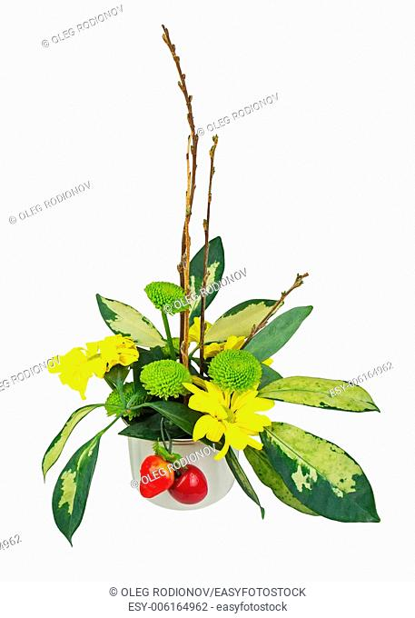 Bouquet from flowers, berries and pussy willows branches in vase isolated on white background