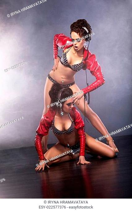 Clubbing. Burlesque. Playful Funny Showgirls with Headphones in Clubwear