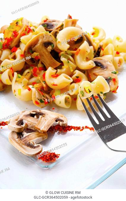 Close-up of macaroni and mushrooms on a platter