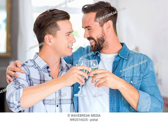 Homosexual couple men toasting with a champagne flute