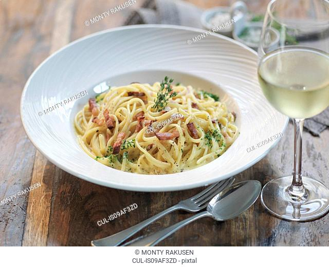 Linguini carbonara made with smoked pancetta, fresh eggs, nutmeg, cream, parmesan cheese and black pepper