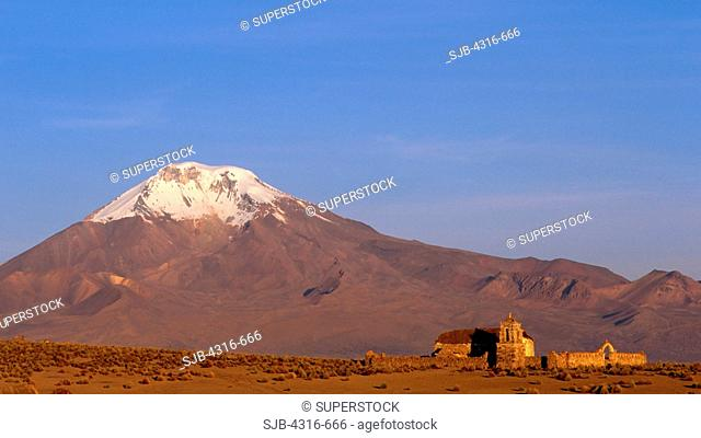 Church Dwarfed by Andean Volcano