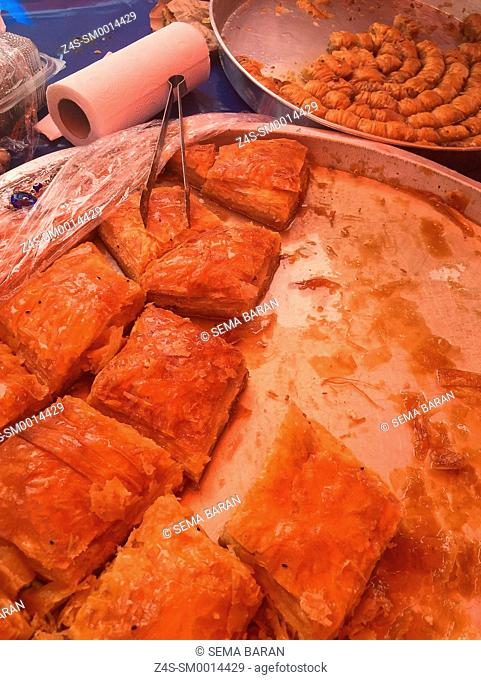 Patties ready to serve in a metal tray at the street market of the Sigacik town, Seferihisar, Izmir, Aegean Coast, Turkey, Europe