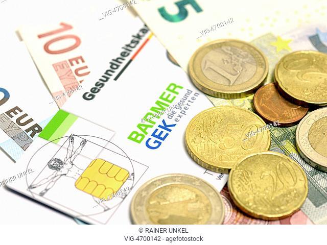 GERMANY, BONN, 06.08.2014, DEU , GERMANY : Euro coins and notes with a German health care card of Barmer GEK insurance company - Bonn, Northrhine-, Germany