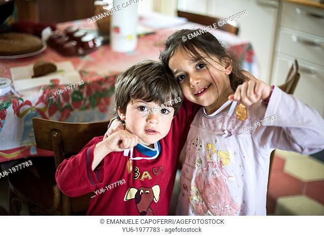 Children brothers, in the morning with pajamas and medal around his neck