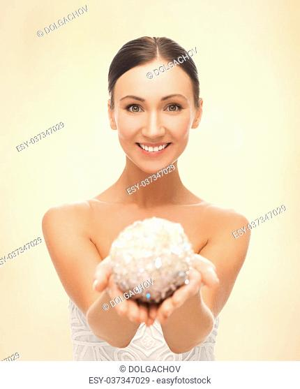 picture of beautiful woman holding sparkling ball