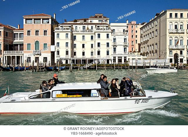 A Water Taxi Passes The Regina Hotel on The Grand Canal, Venice, Italy