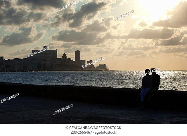 Silhouette of a couple during sunset at the Malecon, Center Havana, La Habana, Cuba, Central America