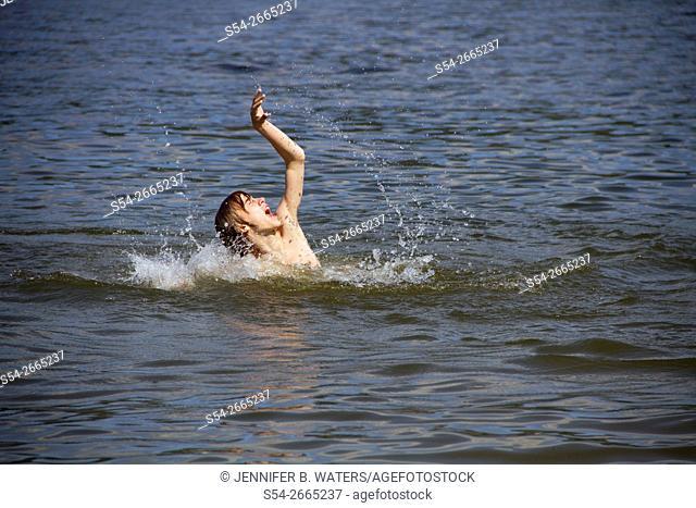 A boy swimming in Liberty Lake, Washington, USA