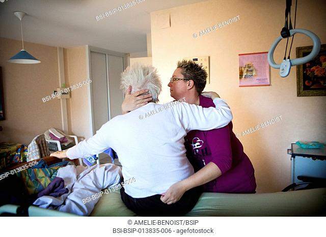 Reportage on a community nurse making home visits in a rural area. She is treating a patient in a nursing home