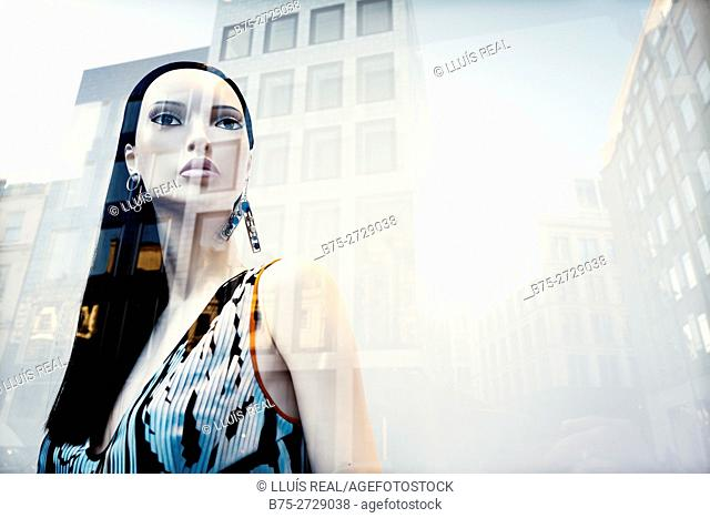 Female mannequin with elegant dress in shop window, fashion shop, reflections on the glass, London, England