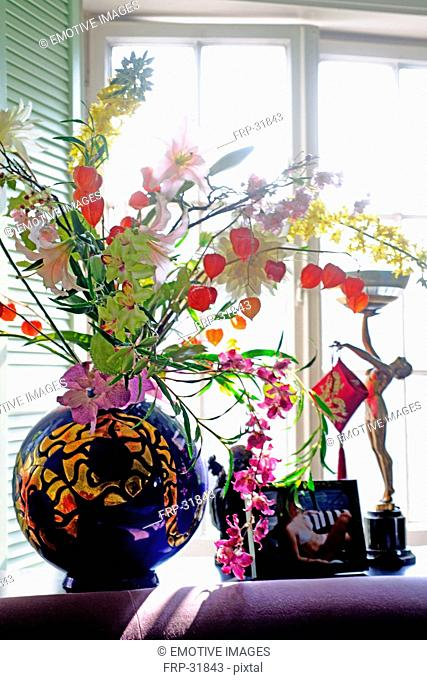 Flowers and decoration in windowsill