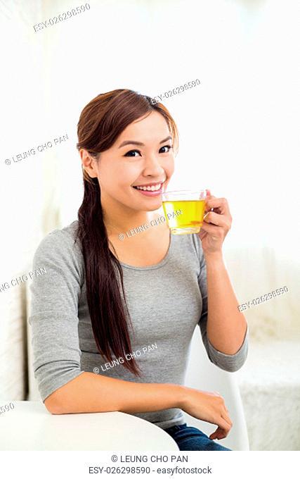 Woman enjoy a glass of tea