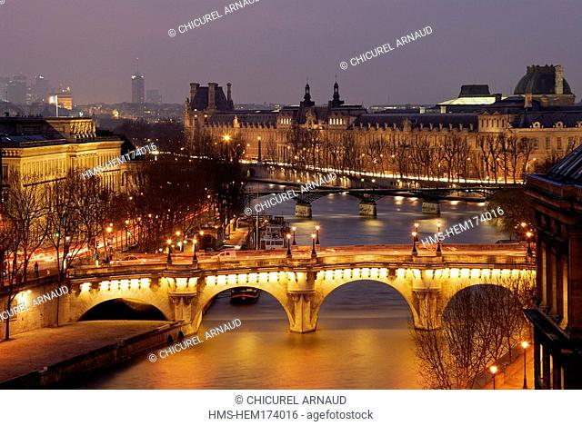 France, Paris, banks of the Seine river listed as World Heritage by UNESCO, Pont Neuf, Louvre museum and Hotel de la Monnaie The Mint on the left