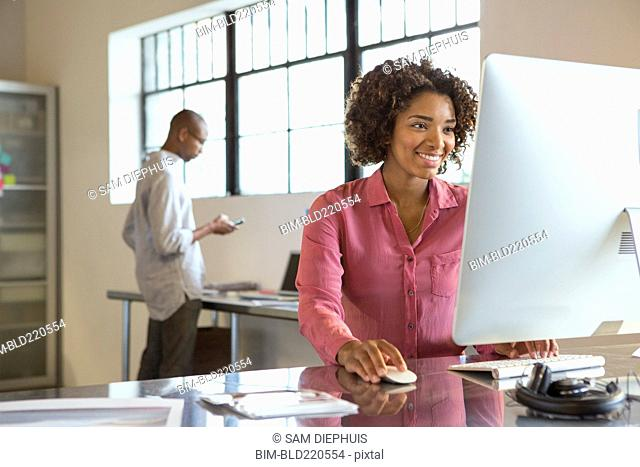 Businesswoman using computer in office