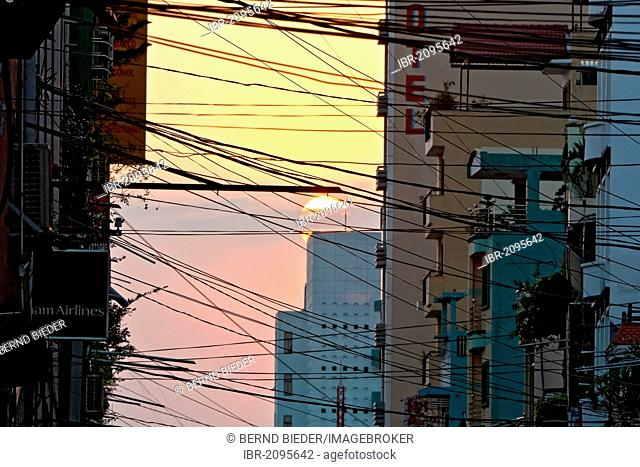 Power lines between houses, evening mood in Ho Chi Minh City, formerly named Saigon, Vietnam, Southeast Asia