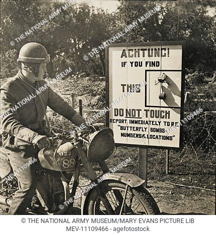 Photograph: Ware butterfly bombs - A passing despatch rider [. . . ] of Dower Street, Flatbridge, [. . . ] read a unique road sign wa[.