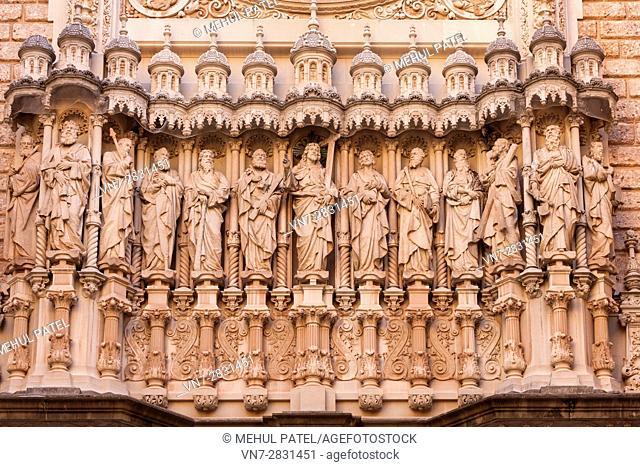 Sculpture on exterior facade of entrance to Basilica of Santa Maria de Montserrat Abbey, Montserrat. Catalonia, Spain