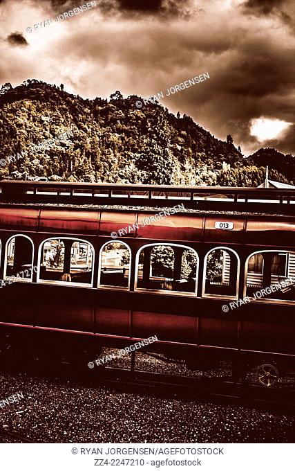 Vintage railway scene of an old train passenger carriage no. 013 captured on dim stormy day. Taken at the heritage ABT Railway Restoration Project in Queenstown...