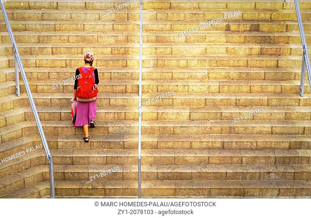 Young girl climbing stairs in Mamilla's new shopping Street Jerusalem