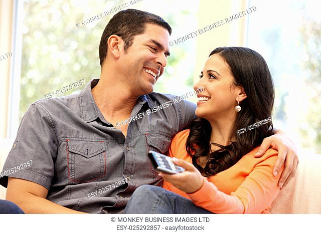 Hispanic couple watching television
