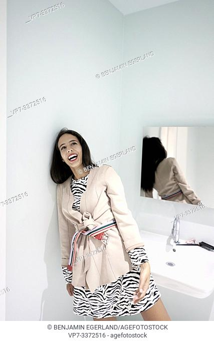 smiling stylish woman in bathroom