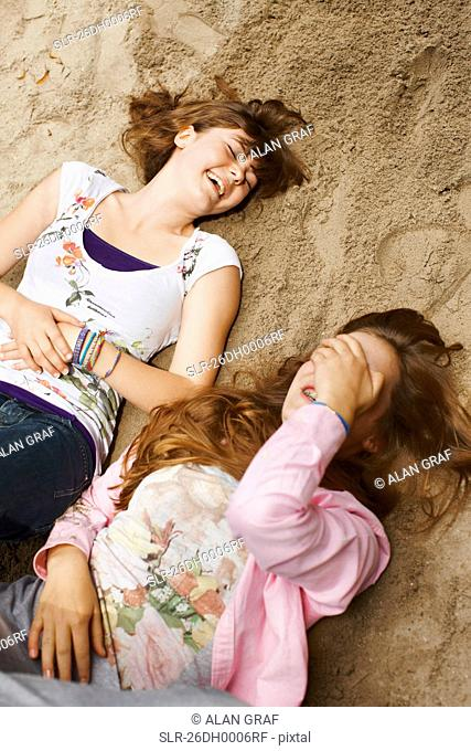 2 girls having fun together in a park