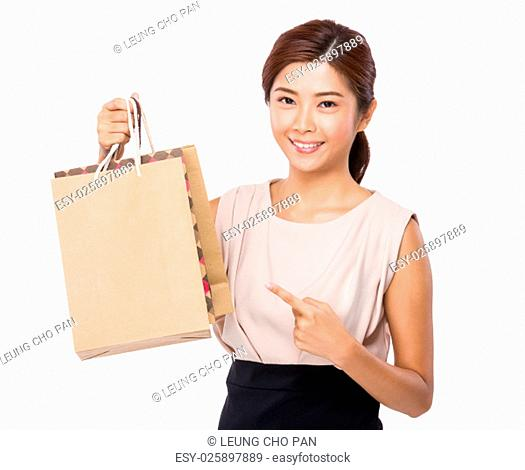 Asian woman finger point to shopping bag
