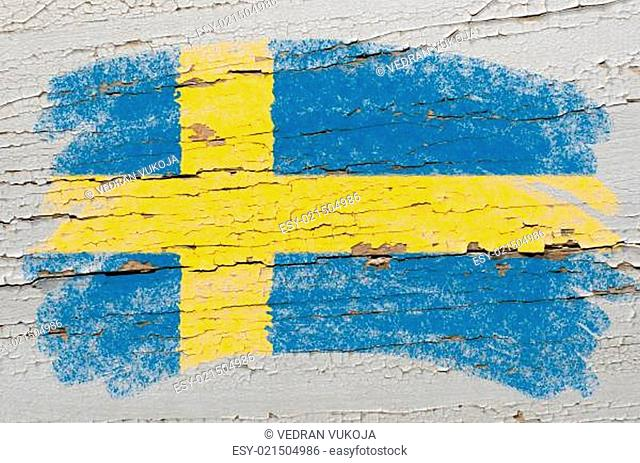flag of Sweden on grunge wooden texture painted with chalk