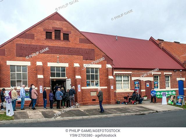 Australian citizens line up in suburban Melbourne to vote in the national election, 2 July 2016. Voting is compulsory. The election was triggered by a double...