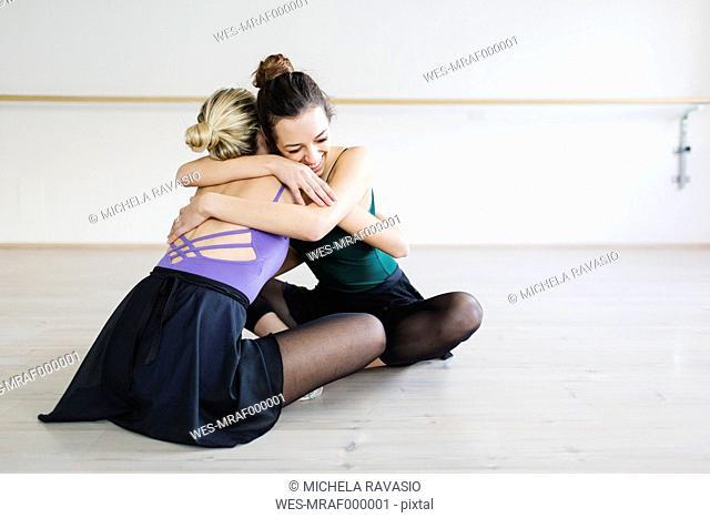 Two girlfriends dancers embracing