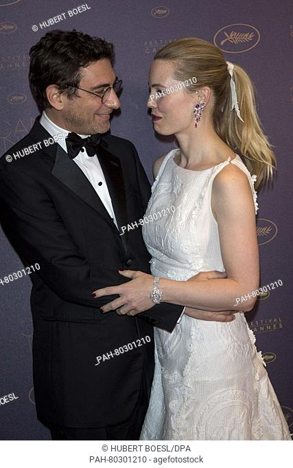 Jean-David Blanc and actress Melissa George attend the Opening Gala Dinner during the 69th Annual Cannes Film Festival at Palais des Festivals in Cannes, France