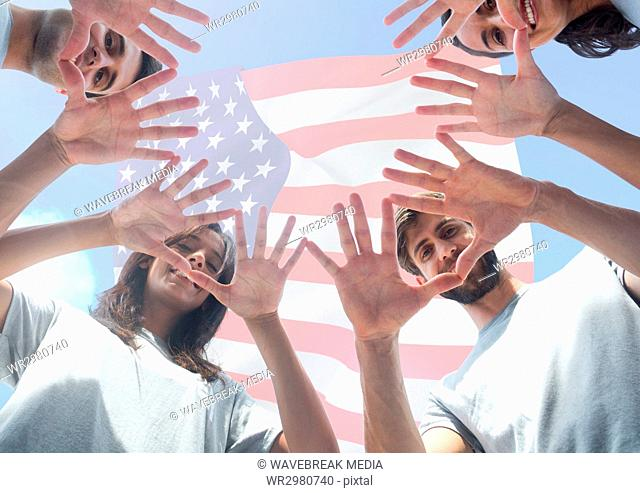 Happy friends with their face between hands for independence day